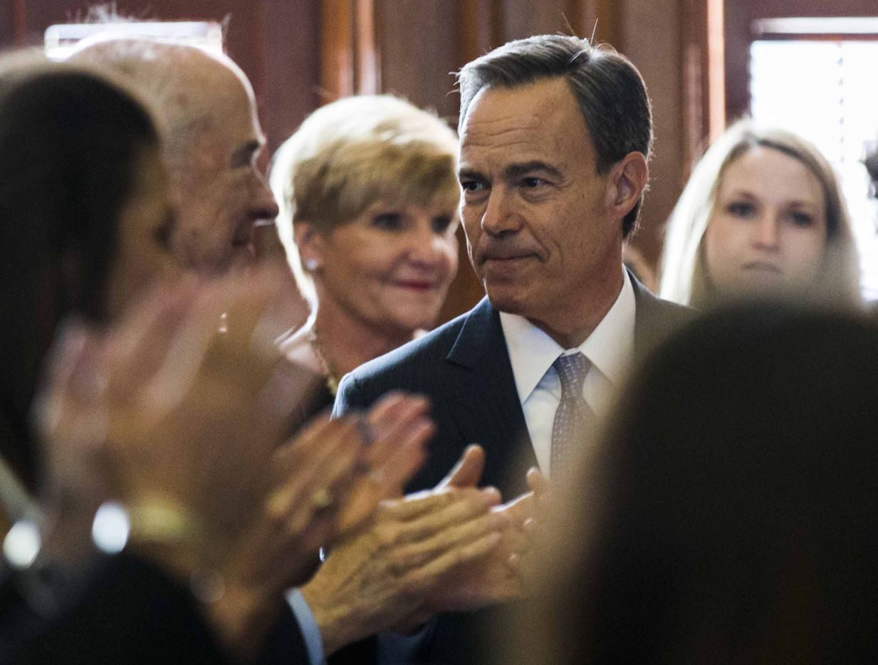 Representatives and their families applaud as state Rep. Joe Straus is elected as Speaker of the House during the first day of the 85th Texas Legislative Session on Tuesday at the Texas State Capitol in Austin.