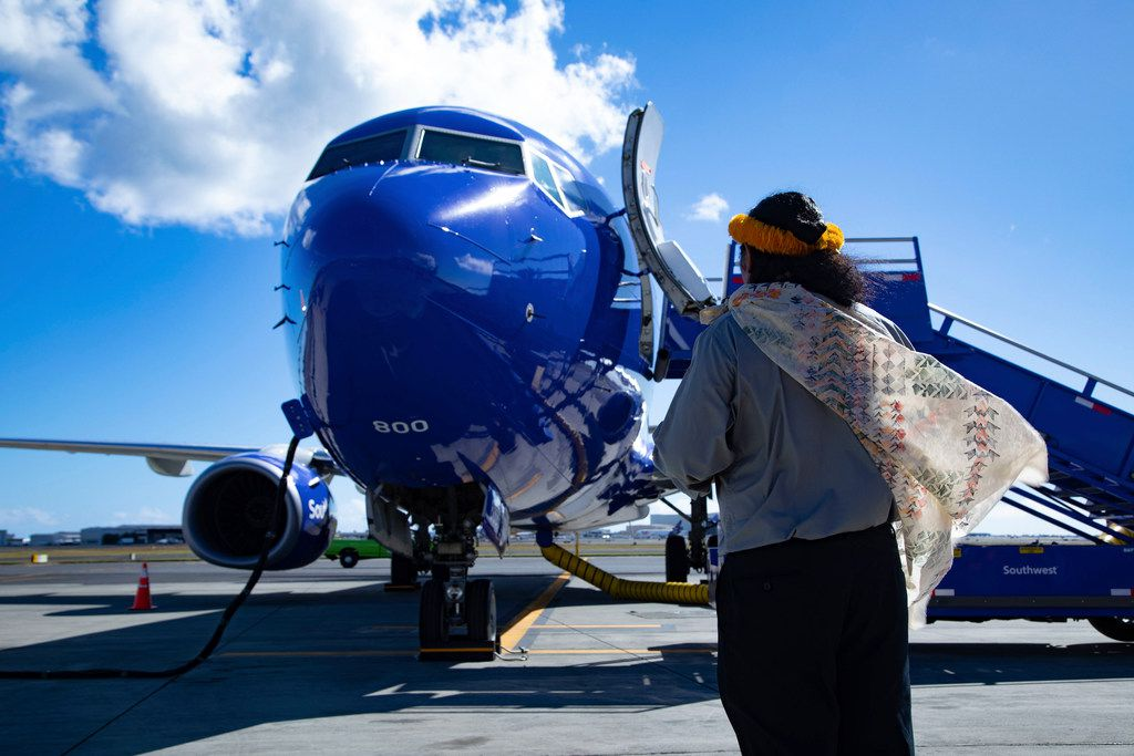 A Hawaiian elder welcomes Southwest Airlines' first ever flight to the Hawaiian Islands with a traditional greeting on Feb. 5, 2019 at Daniel K. Inouye International Airport, in Honolulu. The flight comes as part of Southwest's authorization process with the FAA to offer future scheduled service to Hawaii.