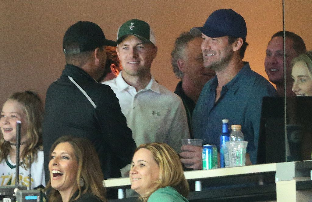 Jordan Spieth and Tony Romo take in the game from a suite during the Dallas Stars vs. the Vegas Golden Knights NHL hockey game at American Airlines Center in Dallas on Friday, October 6, 2017.