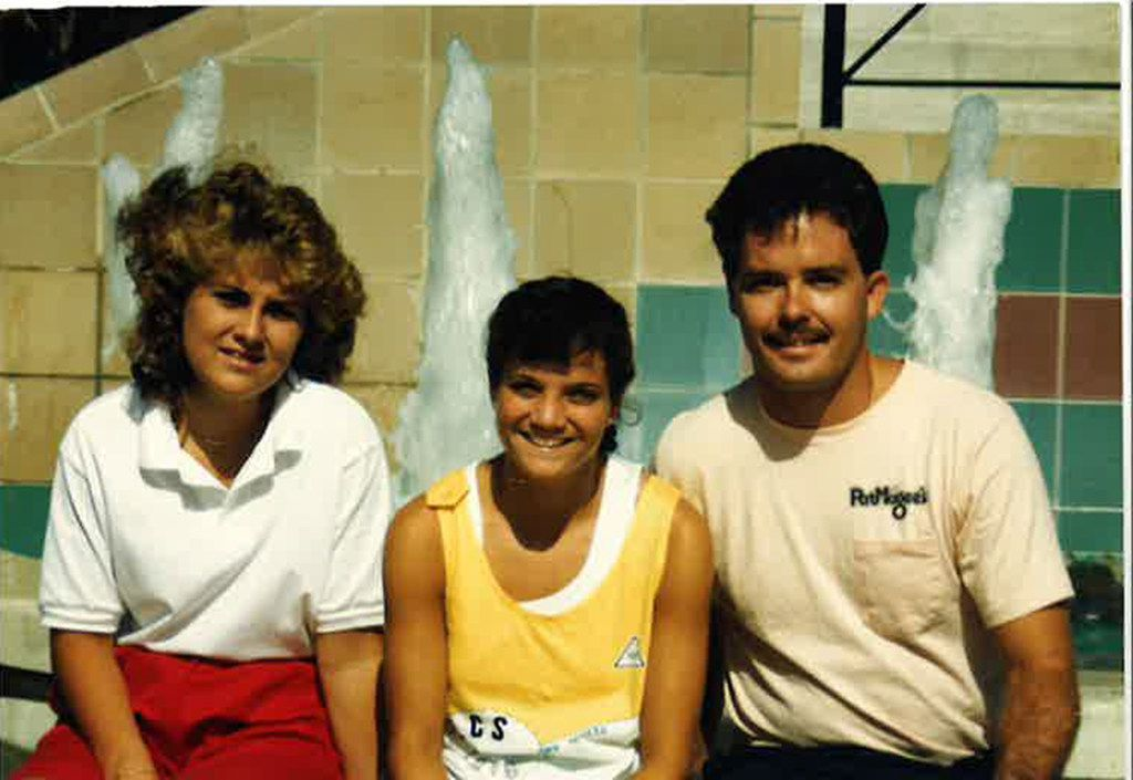 Traci Roberts and Laura Anton pose for a photograph with Tristan Longnecker during the 1986 Olympic Festival in Houston.