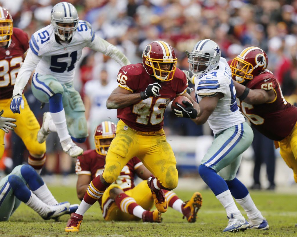 Washington Redskins running back Alfred Morris (46) runs past Dallas Cowboys defensive end Kyle Wilber (51)a nd Dallas Cowboys outside linebacker Bruce Carter (54) during the second half of their NFL game at FedEx Field,  on December 22, 2013.  Dallas won the game 24-23. (Michael Ainsworth/The Dallas Morning News)