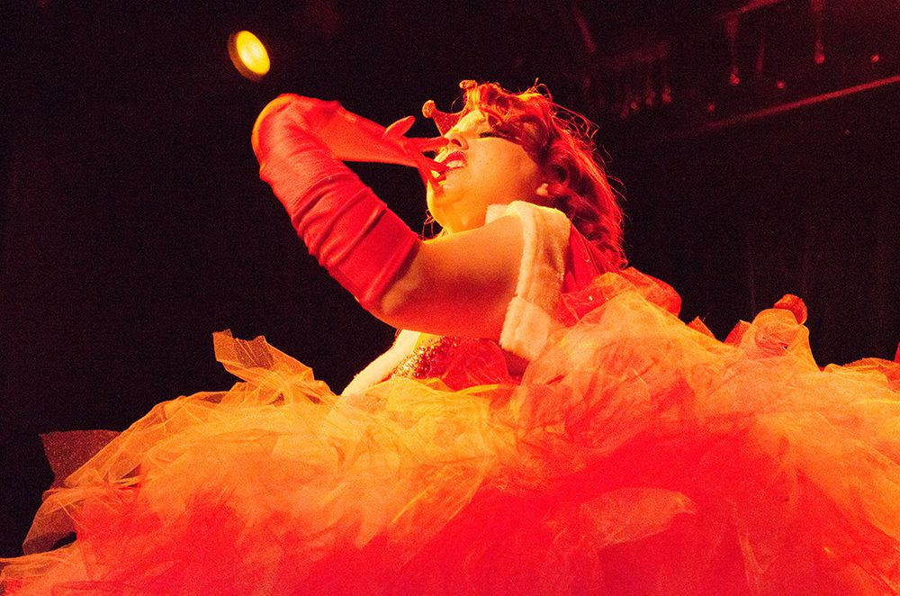 Kitty Martini pulls off her gloves during her performance as the Peppermint Princess at the Nearly Naked Nutcracker.