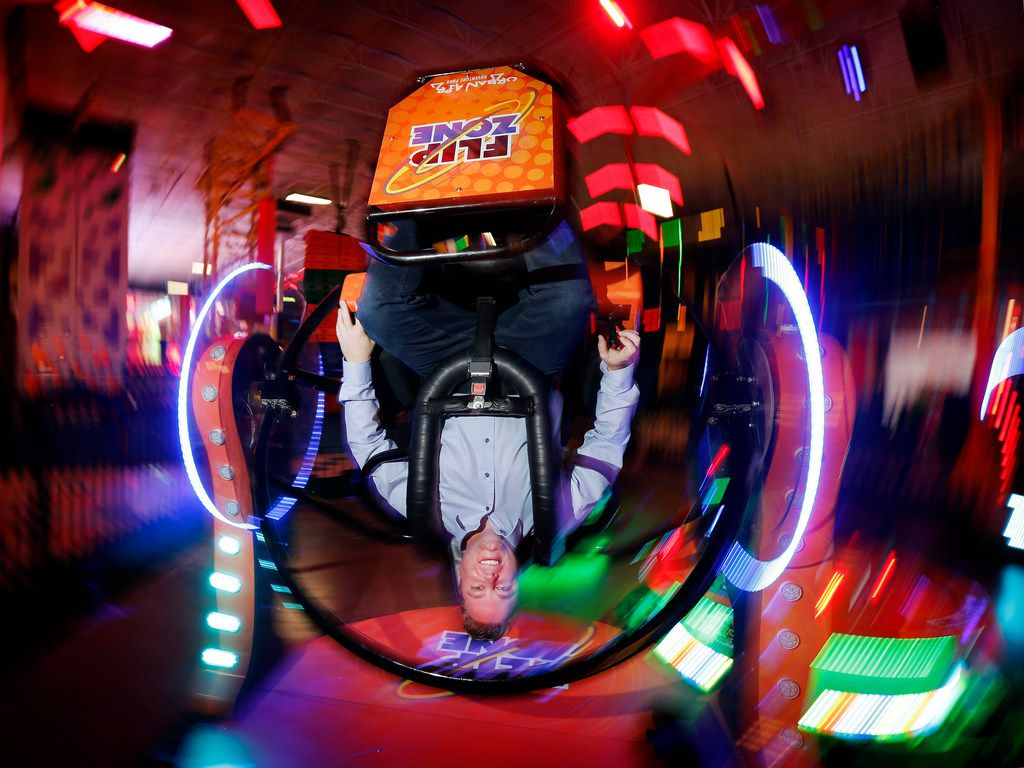 Urban Air Adventure Park CEO Michael Browning takes a spin in the Spin and Flip Zone at its flagship location in Southlake.