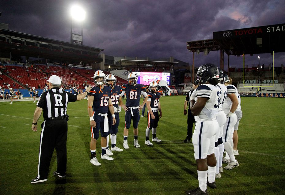 Team captains meet at midfield for the coin toss under ominous clouds as Wakeland High School hosted Lone Star High School at Toyota Stadium in Frisco on Friday night, October 20, 2017. (Stewart F. House/Special Contributor)