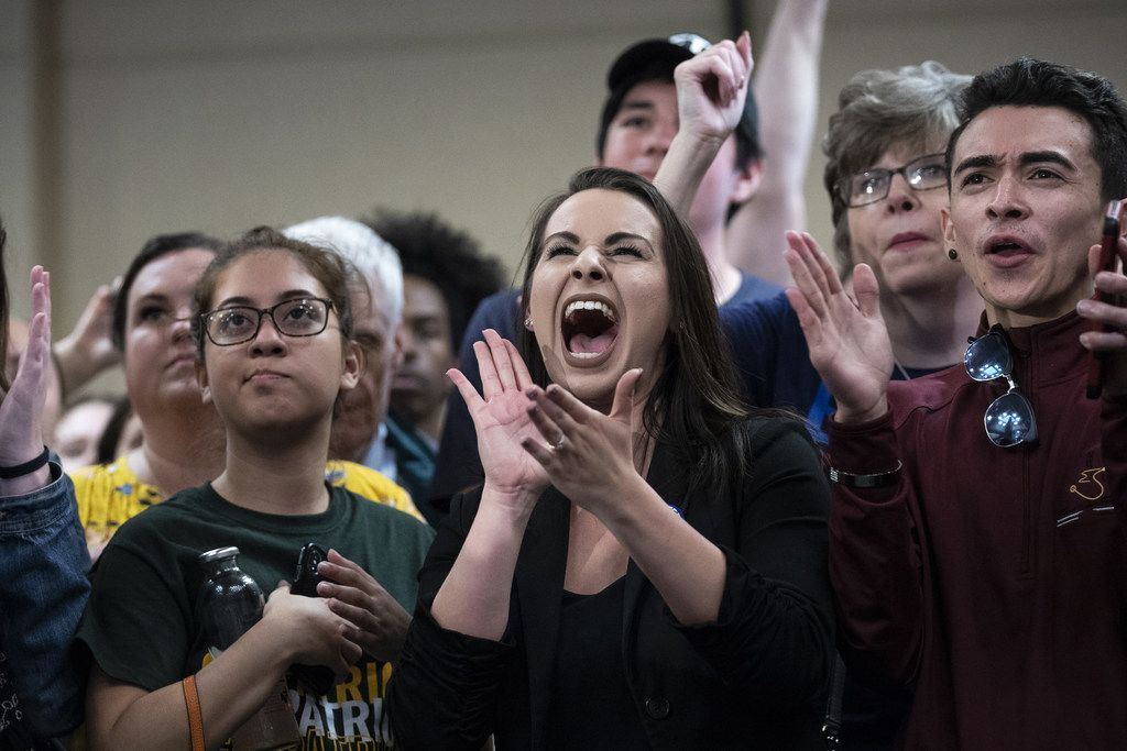 Supporters cheer as Beto O'Rourke speaks during a town hall in Alexandria, Va.