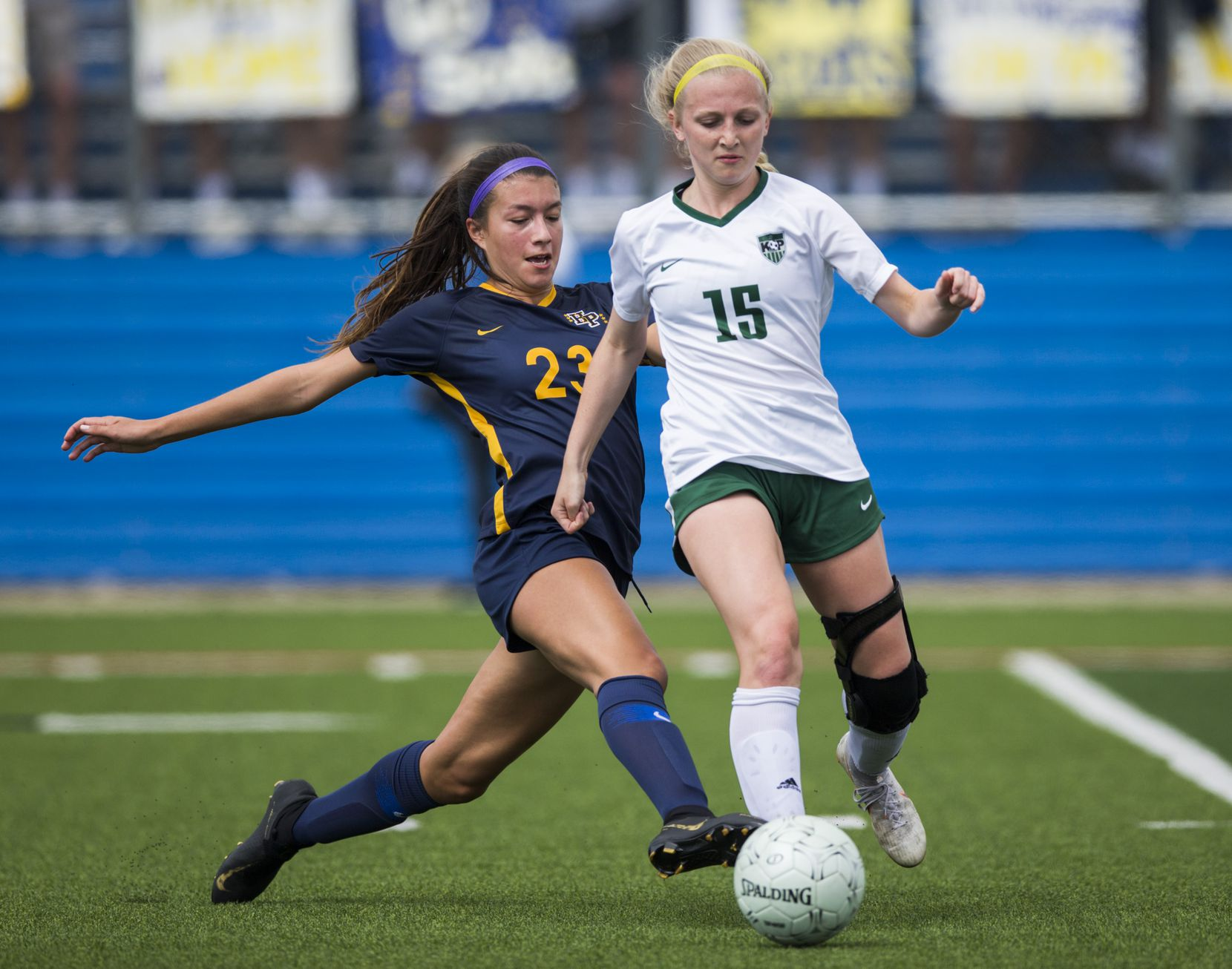 Highland Park forward Maja Davison (23) tries to get the ball from Humble Kingwood Park midfielder Brooke Baldon (15) during the second half of a UIL conference 5A girls state semifinal soccer game between Highland Park High School and Humble Kingwood Park High School on Thursday, April 18, 2019 at Birkelbach Field in Georgetown, Texas. (Ashley Landis/The Dallas Morning News)