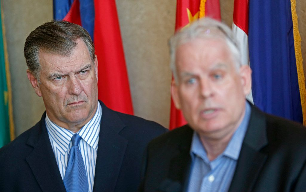 Mayor Mike Rawlings (left) watches Neville R. Ray, Executive Vice President and Chief Technology Officer of T-Mobile, during a press conference about the 911 issue with T-Mobile at Dallas City Hall on Wednesday, March 15, 2017, in Dallas. (Jae S. Lee/The Dallas Morning News)