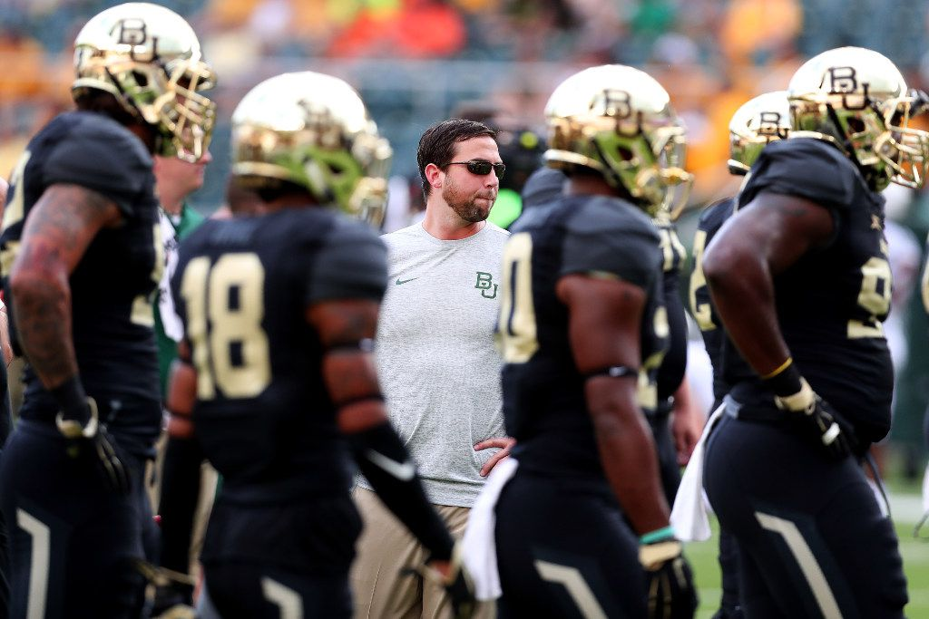 Offensive coach Kendal Briles and members of the Baylor football team.