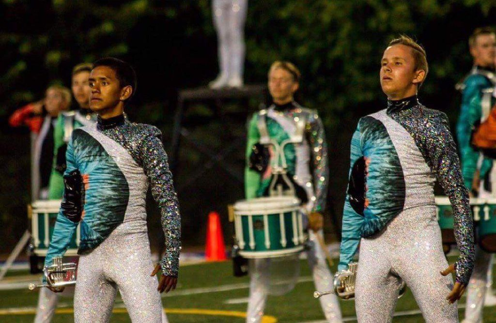 David Johnson (right) performs with the Blue Knights in uniform.