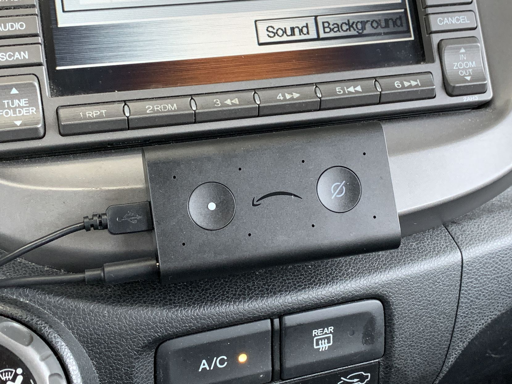 The Echo Auto in its spot under my car's navigation screen.
