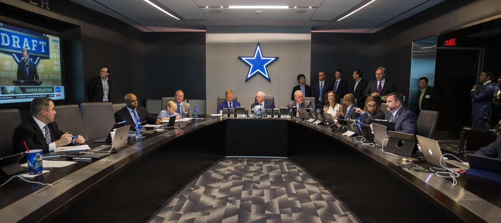 Dallas Cowboys head coach Jason Garrett, team owner Jerry Jones, executive vice president and CEO Stephen Jones, executive vice president and chief brand officer Charlotte Jones Anderson and other executives discuss players in the war room during round one of the 2017 NFL Draft on Thursday, April 27, 2017, at The Star in Frisco.