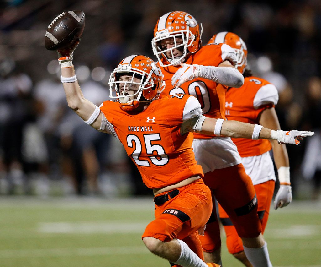 Rockwall's Corey Kelley (25) celebrates after intercepting a pass intended for  Arlington Martin's Jonathan Carter (88)  during the first half of play at Wilkerson-Sanders Memorial Stadium in Rockwall, Texas on Friday, September 20, 2019. (Vernon Bryant/The Dallas Morning News)