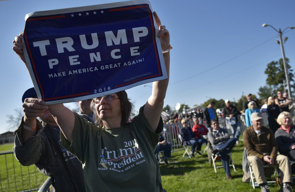 "A Donald Trump supporter makes her point during the 1st Congressional District Republican Party of Wisconsin Fall Fest. House Speaker Paul Ryan, ""sickened"" by Trump's lewd and misogynistic comments in a 2005 video, disinvited him from the annual political event."