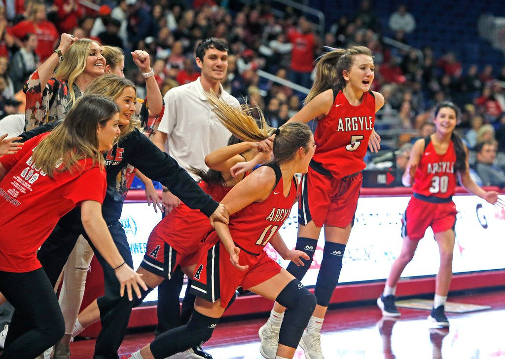 Argyle's Rhyle McKinney leads the charge after the final buzzer. UIL girls basketball 4A State final between Argyle and Hardin-Jefferson on Saturday,  March 2, 2019 at the Alamodome in San Antonio, Texas. (Ron Cortes/ Special Contributor) ORG XMIT: 10043975A