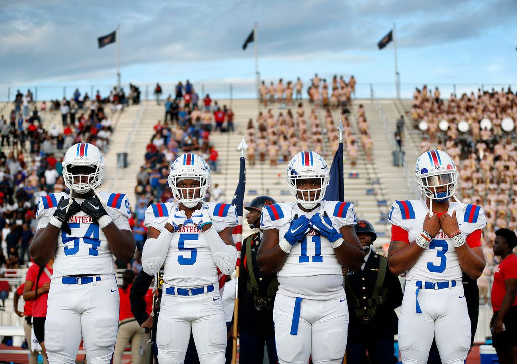 Duncanville team captains Savion Byrd (54), Christopher Thompson (5), James Mitchell (11) and Ja'Quinden Jackson (3) wait to walk out for the coin toss before their season opening game against Lancaster at Beverly D. Humphrey Tiger Stadium in Lancaster Texas, Friday, August 30, 2019. (Tom Fox/The Dallas Morning News)