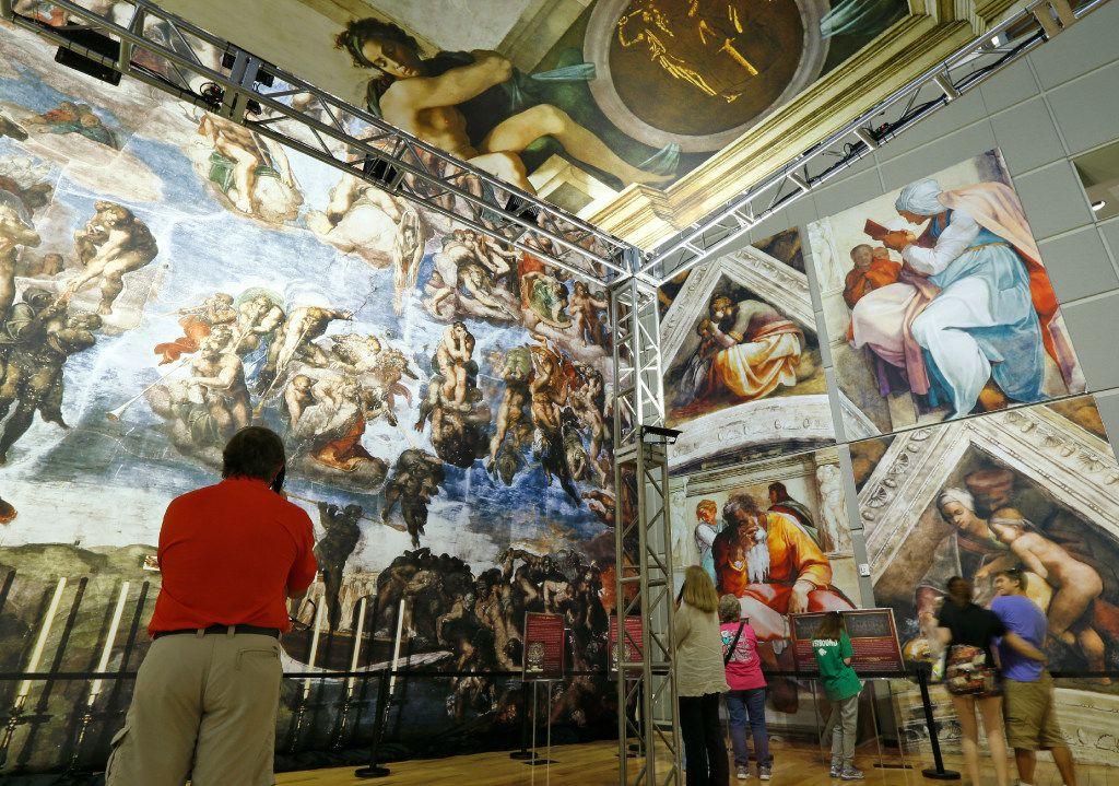 People look at the photo reproduction of the Sistine Chapel at Fair Park. (Nathan Hunsinger/The Dallas Morning News)