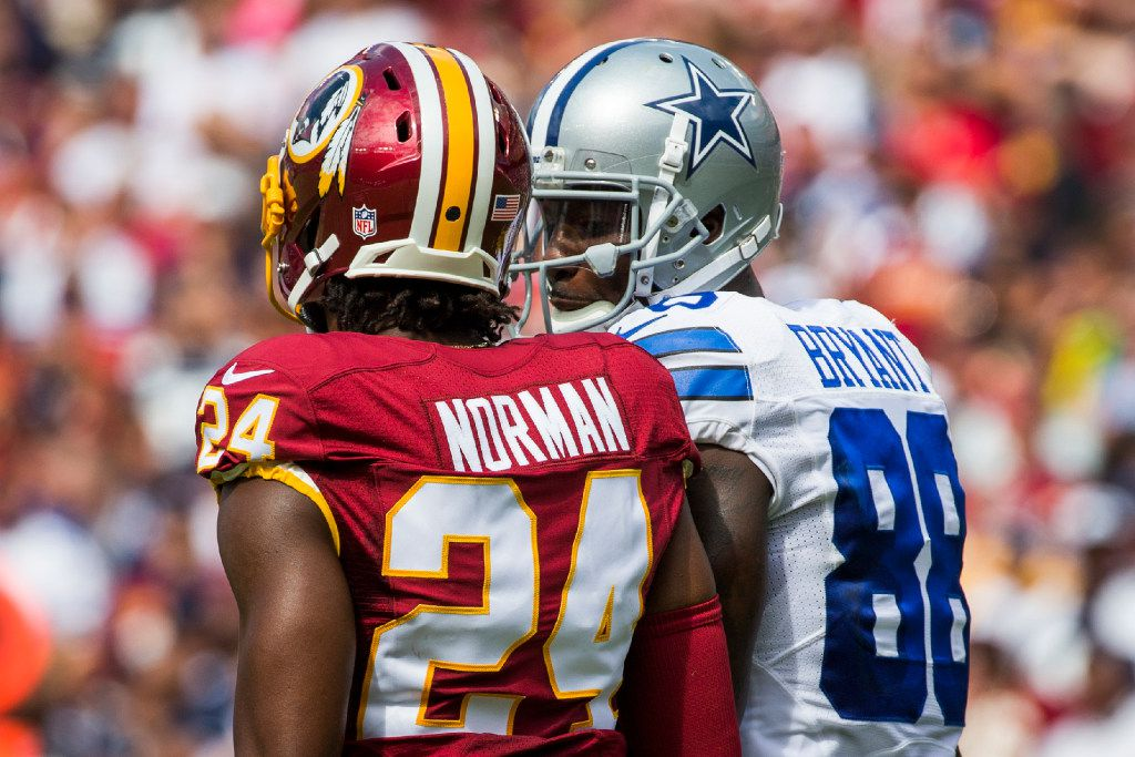 Dallas Cowboys wide receiver Dez Bryant (88) talks with Washington Redskins cornerback Josh Norman (24) during the first half of an NFL football game in Landover, Md., Sunday, Sept. 18, 2016. (Smiley N. Pool/The Dallas Morning News)