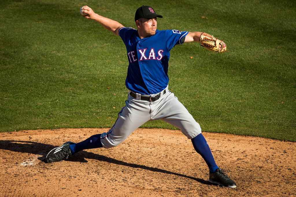 Texas Rangers pitcher Adrian Sampson pitches during the seventh inning against the Chicago Cubs in a spring training baseball game on Saturday, Feb. 24, 2018, in Mesa, Ariz. (Smiley N. Pool/The Dallas Morning News)