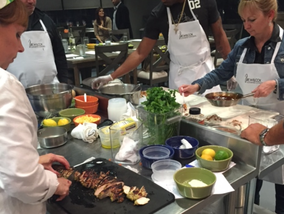Students at Tre Wilcox Cooking Concepts slice and dice at work stations to prepare the first course for a Texas Grilling Steakhouse cooking class.