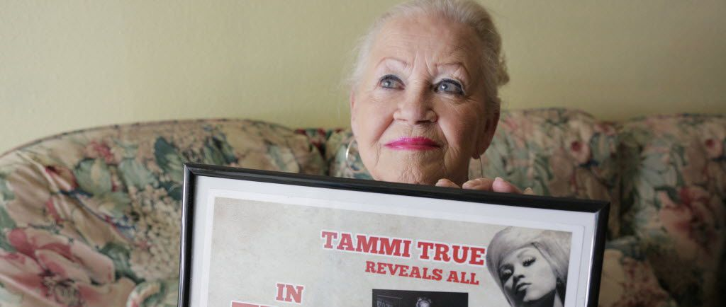Nancy Myers poses in her Grand Prairie home with a framed poster from 1963, when she worked as a stripper under the stage name Tammi True at Jack Ruby's Carousel Club in Dallas.