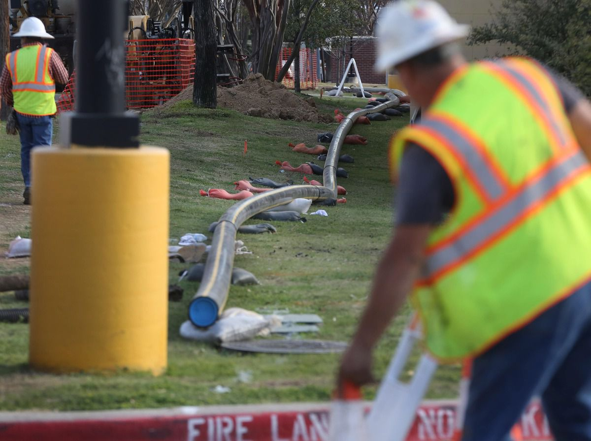 """Crews worked last year along Midway Road to replace gas lines after one house exploded and two others burned in northwest Dallas. Atmos replaced the entire distribution system there after it was deemed """"too dangerous to operate,"""" records show."""