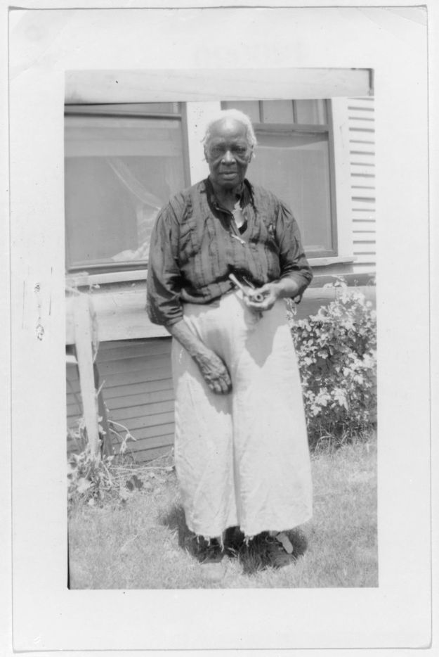 Julia Daniels, ex-slave, shown in Dallas, on Sept. 9, 1937. The photo is from a collection of portraits of African American ex-slaves created by the U.S. Works Progress Administration, for the Federal Writers' Project slave narratives collection.