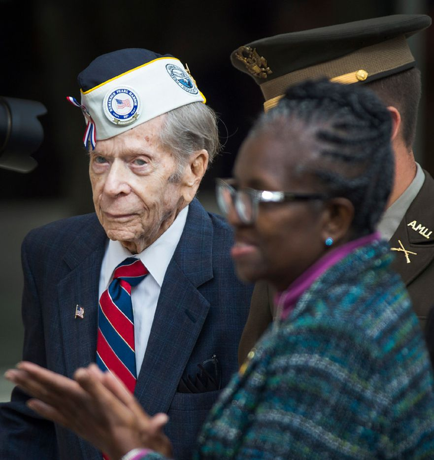 Pearl Harbor veteran Aaron Cook, 94, of Houston, who was at Ford Island during the attack, is applauded as he arrives for a 75th Anniversary of Pearl Harbor commemoration at the George Bush Presidential Library on Wednesday, Dec. 7, 2016, in College Station, Texas. (Smiley N. Pool/The Dallas Morning News)