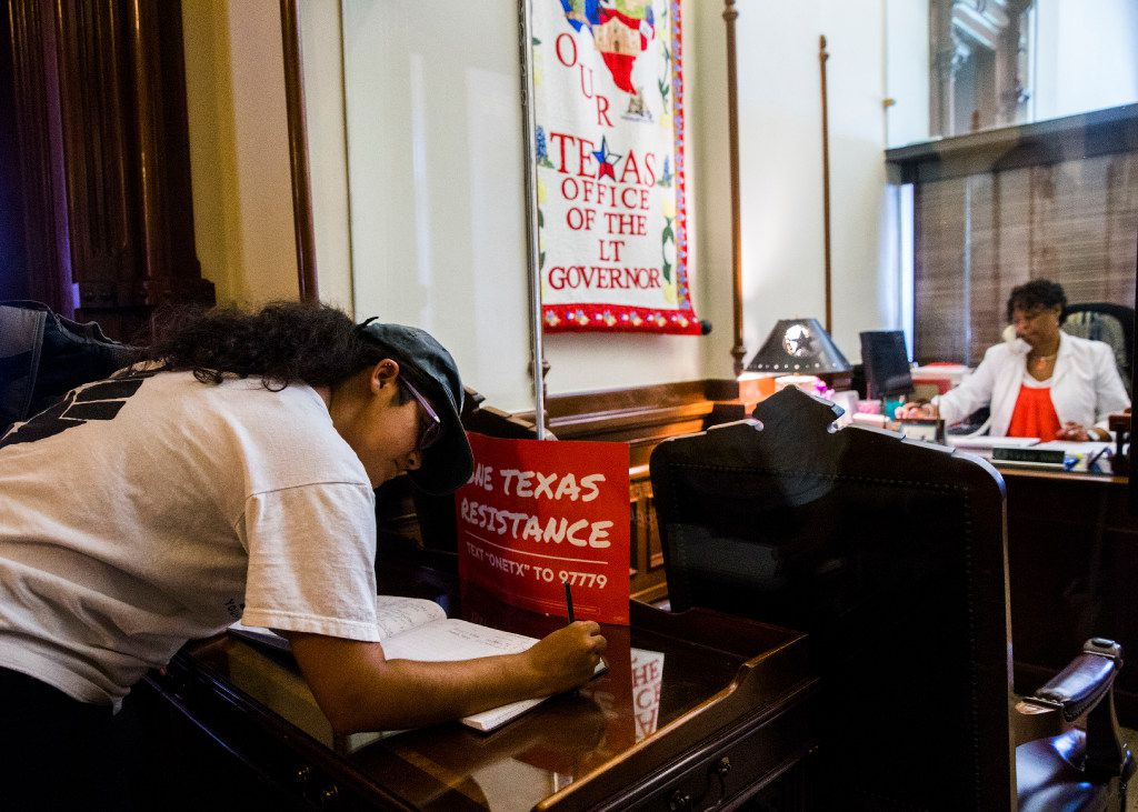 Amanda Cavazos Weems signs the guestbook of Lt. Gov. Dan Patrick during a One Texas Resistance rally on the first day of a legislative special session on Tuesday, July 18, 2017 at the Texas state capitol in Austin, Texas. Demonstrators were told they could not protest outside Patrick's office, so they each signed his guestbook in the hallway. (Ashley Landis/The Dallas Morning News)