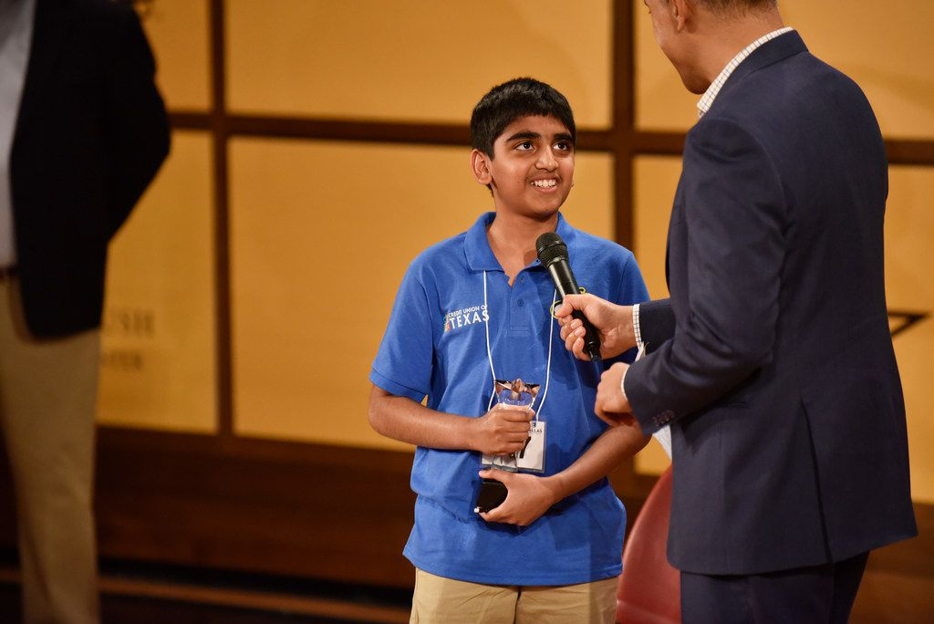 Abhijay Kodali, of Denton County, is interviewed by WFAA news anchor Chris Lawrence after winning first place at the 61st annual Golden Chick Dallas Regional Spelling Bee at the George W. Bush Presidential Center on the campus of Southern Methodist University in Dallas on March 9, 2019. Kodali will advance with two second-place finishers to the National Spelling Bee in Washington D.C.