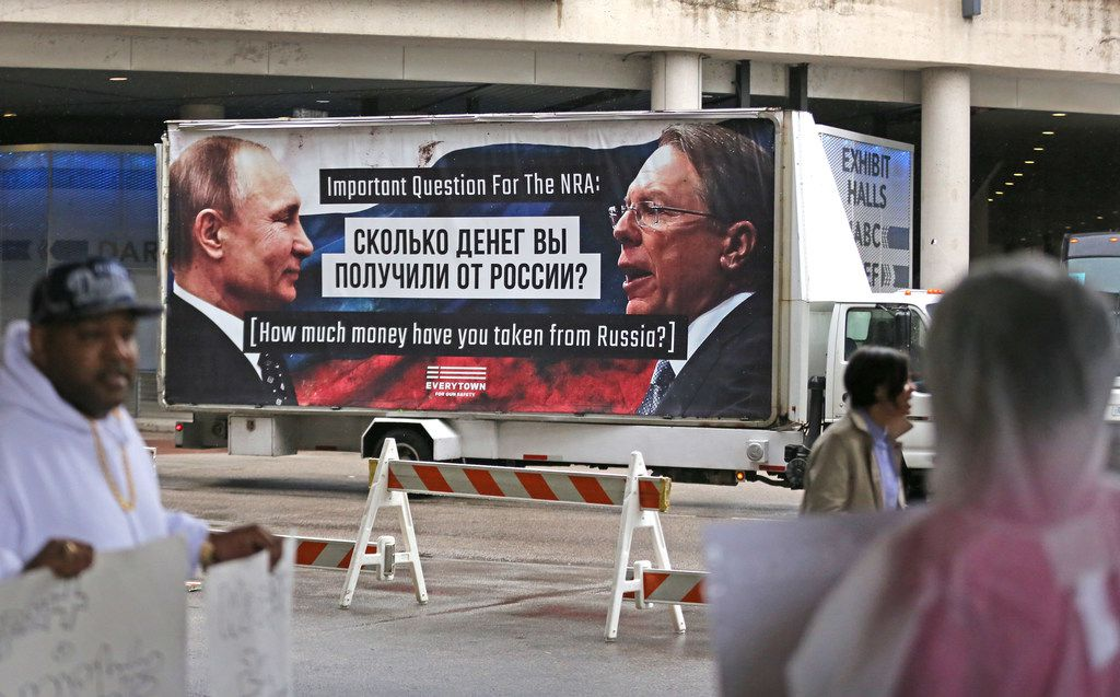 A mobile billboard makes its way around the Kay Bailey Hutchinson Convention Center during the NRA Convention in downtown Dallas on Friday, May 4, 2018.  (Louis DeLuca/The Dallas Morning News)