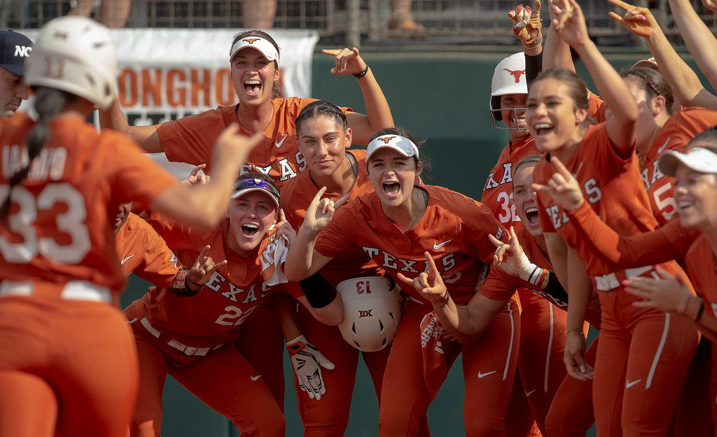 Texas players celebrate a home run hit by catcher Mary Iakopo (33) against Sam Houston State during an NCAA college softball game on Friday, May 17, 2019, in Austin, Texas. (Nick Wagner/Austin American-Statesman via AP)