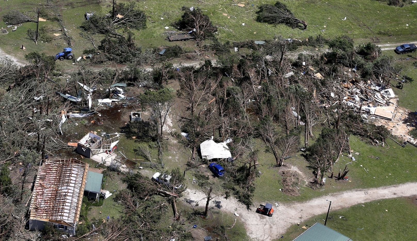 Damaged houses and downed trees lie flattened in Canton, Texas, Sunday, April 30, 2017. Severe storms including tornadoes swept through several small towns killed at least four people in East Texas yesterday.