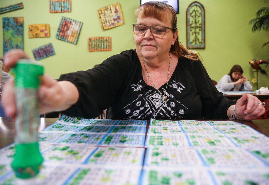 Jeannie Masconi, of Duncanville, Texas, marks her cards during a round of bingo at Jackpot Bingo on Thursday, April 11, 2019 in Duncanville, Texas.