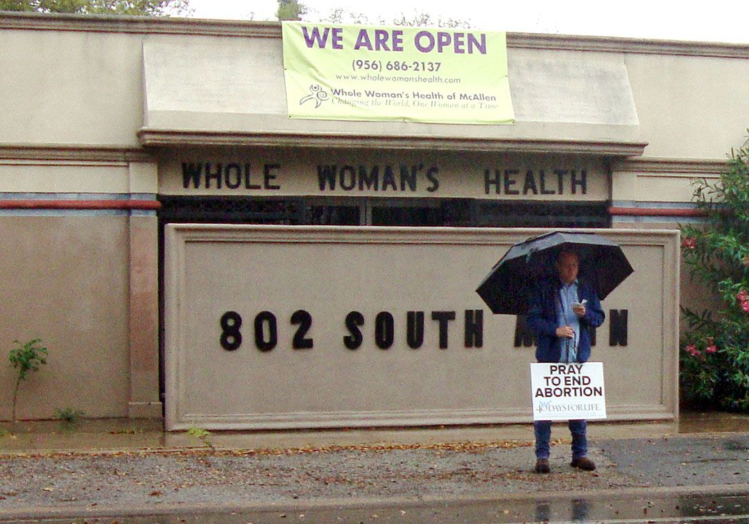 A protestor in McAllen, Texas stands in front of Whole Woman's Health, which is lead plaintiff in a lawsuit before the Supreme Court to block the Texas law that has already contributed to the closing of about half of the state's more than 40 abortion clinics. (Molly Hennessy-Fiske/Los Angeles Times/TNS)