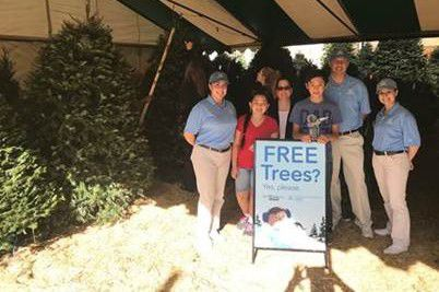 The Helpful Honda group turned into helpful blue elves by surprising more than 150 families with complimentary, full-size holiday trees. They gave out trees at Ruibal's Plants of Texas and Mainstay Farm. Photo from Honda.