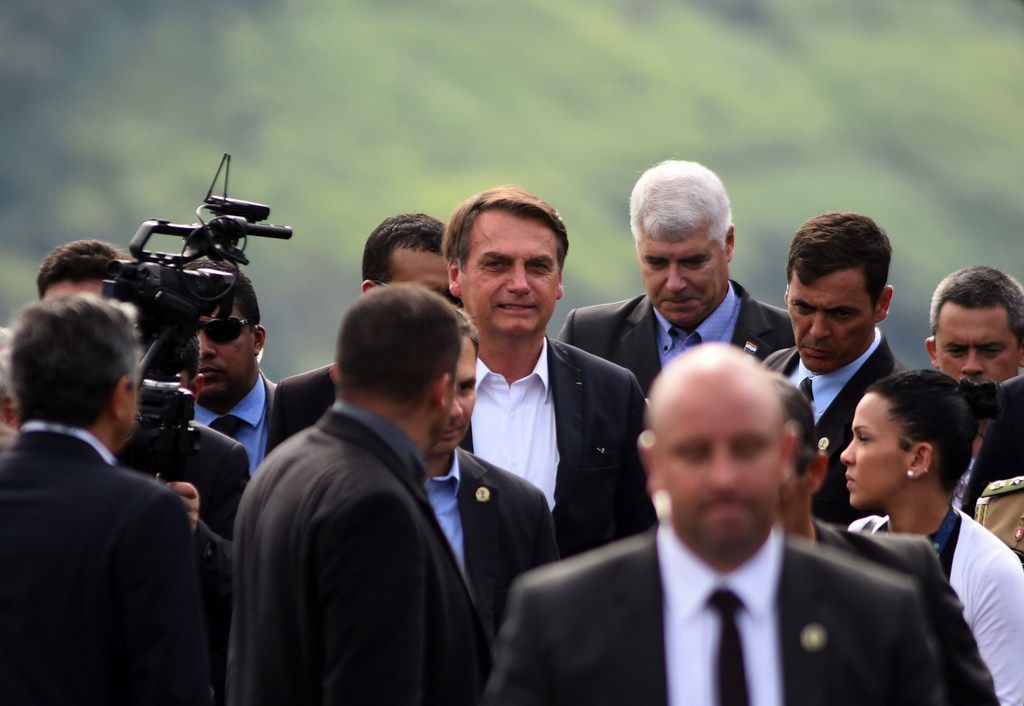 Brazilian President Jair Bolsonaro (C) walks during a ceremony to launch the foundation stone of a second bridge that will conect Foz de Yguazu, Brazil with Presidente Franco, Paraguay, taken in Foz de Iguacu, on May 10, 2019. (Photo by NORBERTO DUARTE / AFP)NORBERTO DUARTE/AFP/Getty Images