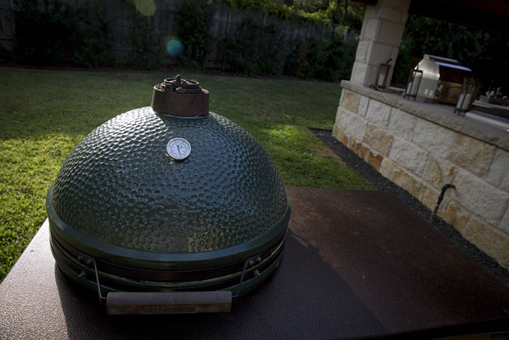 A Big Green Egg grill sits off to the side of the outdoor cooking area at chef Kent Rathbun's home Wednesday, November 11, 2015 in Dallas. (G.J. McCarthy/The Dallas Morning News)