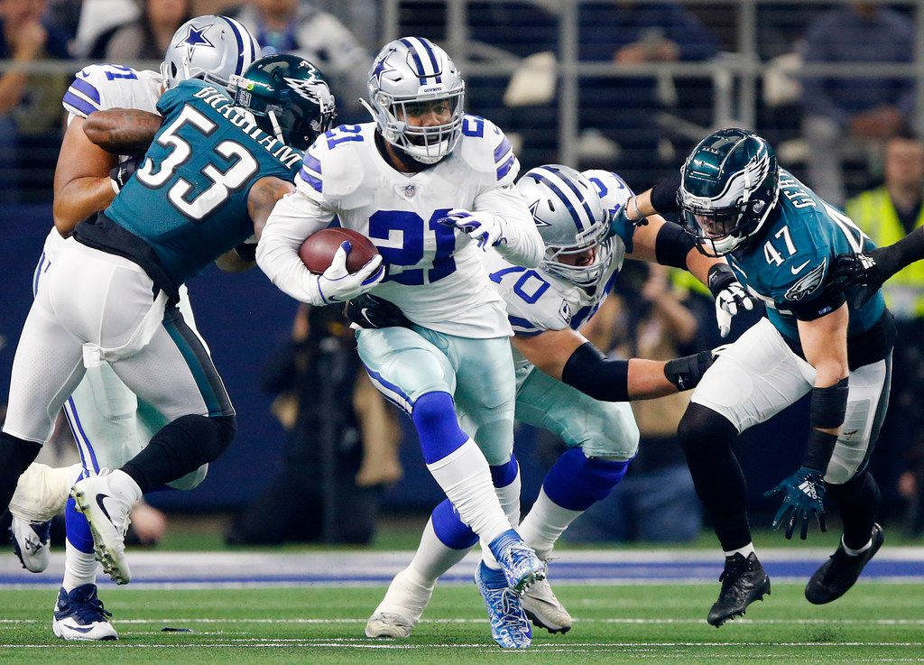 Dallas Cowboys offensive guard Zack Martin (70) and provides a block for Dallas Cowboys running back Ezekiel Elliott (21) against the Philadelphia Eagles in the first quarter at AT&T Stadium in Arlington, Texas, Sunday, December 9, 2018. (Tom Fox/The Dallas Morning News)