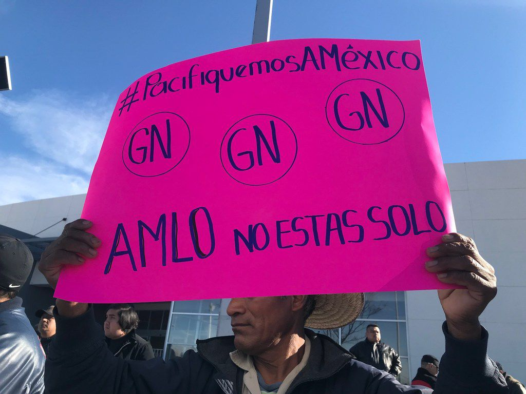 Raymundo Ramirez supportsl Lopez Obrador's plan to create a national guard to make Mexico safe again. Demonstrating Saturday in Ciudad Juarez, he said the new  national guard was needed because local and state police are dangerous and corrupt.