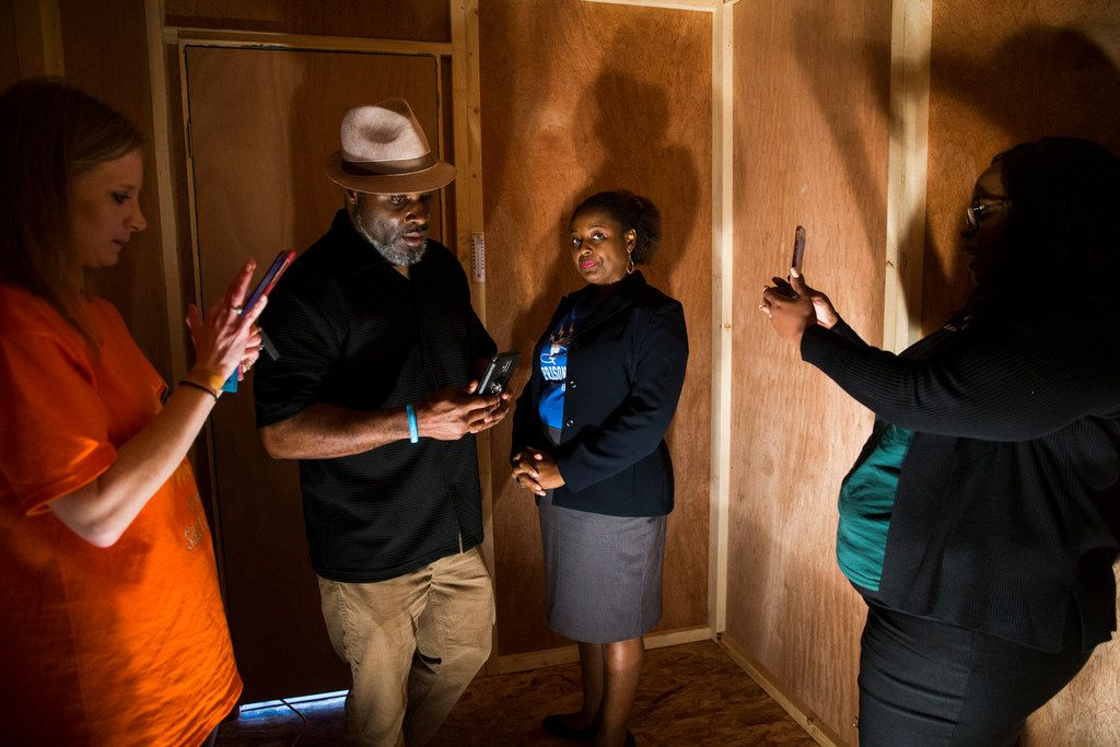 From left, Casey Phillips, founder and president of Texas Prisons Air-Conditioning Advocates; Robert Lilly, who was incarcerated in the Wallace Unit; attorney Tamika J. Solomon; and Savannah Eldrige, whose brother and step-son are both incarcerated at the Allred Unit, step in to a heated, mock prison cell outside the state capitol on Tuesday, March 12, 2019 in Austin. Texas Prisons Air-Conditioning Advocates set up the cell, and challenged people to spend three minutes inside.