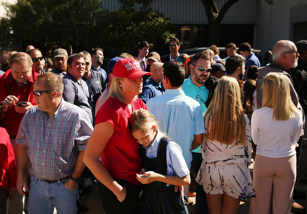 Supporters of President Donald Trump wait for the arrival of Trump before his visit to Dallas while at Signature Flight Support near Love Field in Dallas Wednesday October 25, 2017. President Trump participated in a hurricane recovery briefing, a Republican National Committee roundtable and gave remarks at a reception. (Andy Jacobsohn/The Dallas Morning News)