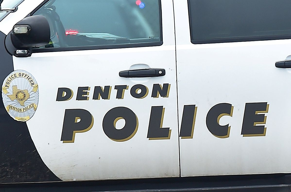 Denton police arrested an attorney accused of firing a gun in the law firm where she had just lost her job earlier that day.