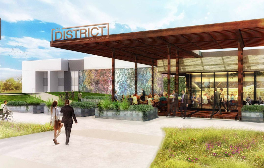 The new food hall building at Legacy Central overlooks a park.