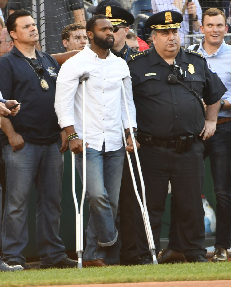 Capitol Police officer David Bailey, who was injured in the shootout during the Congressional baseball practice on Wednesday, was in attendance at Thursday's game in Washington. Must credit: Washington Post photo by Jonathan Newton