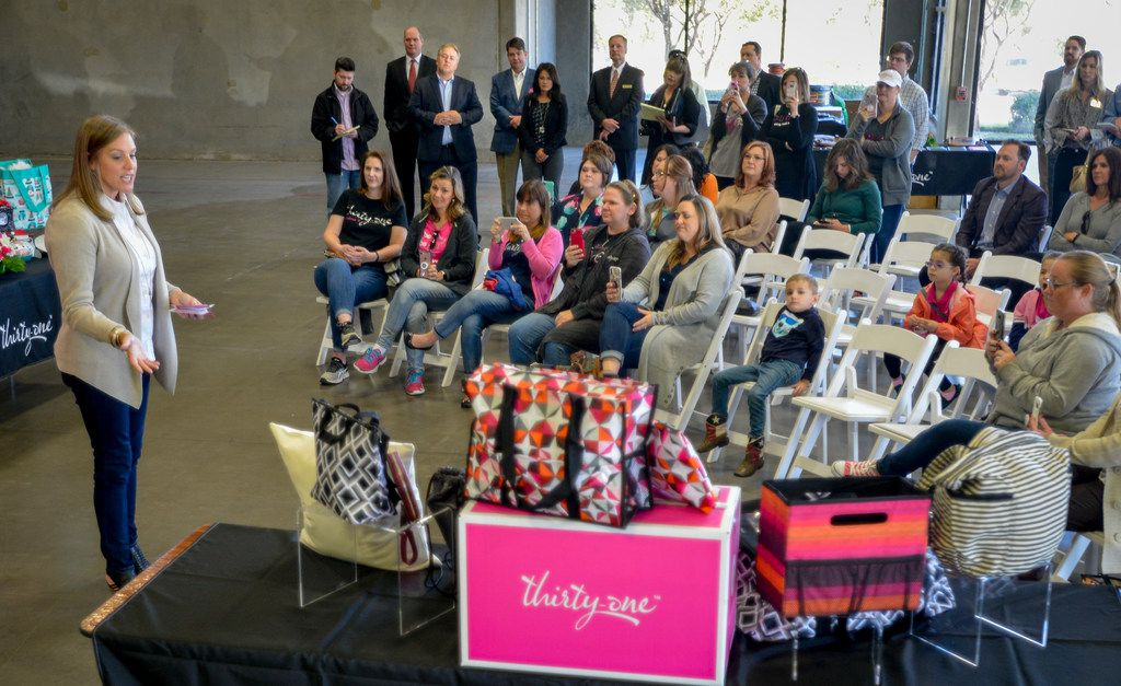 Thirty-One Gifts CEO Cindy Monroe, left, speaks to guests during an event inside the company's new facility in Flower Mound, Texas on November 2, 2018. (Robert W. Hart/Special Contributor)