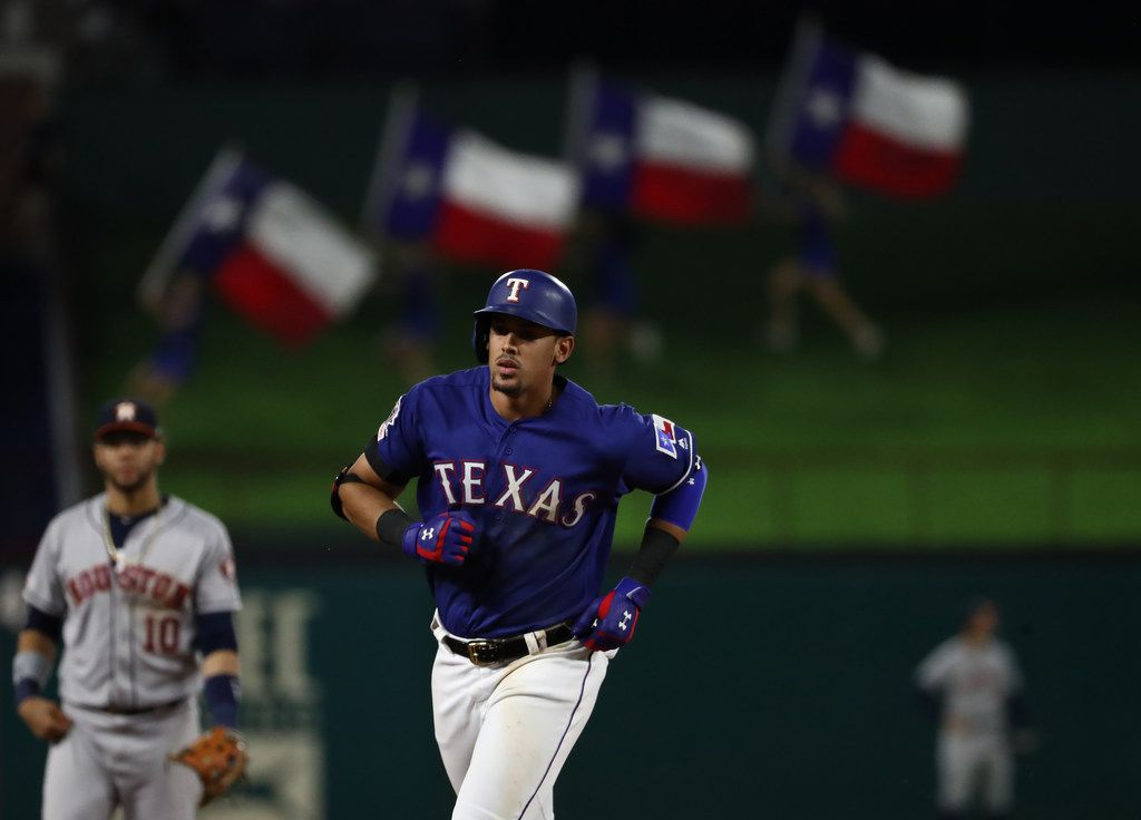 ARLINGTON, TEXAS - JULY 12:  Ronald Guzman #11 of the Texas Rangers runs after a two-run homerun against the Houston Astros in the eighth inning at Globe Life Park in Arlington on July 12, 2019 in Arlington, Texas. (Photo by Ronald Martinez/Getty Images)