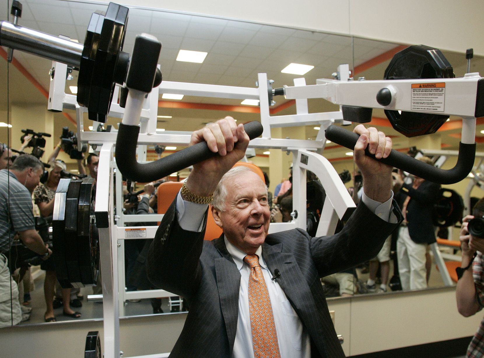 Pickens tried out a machine in the new weight room at Oklahoma State in 2009. Through a series of donations, Pickens provided the bulk of the funding for a $286 million stadium overhaul.