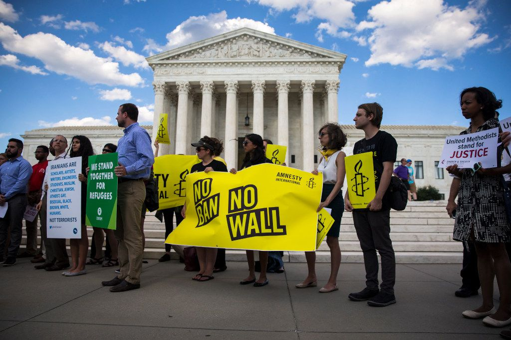 Demonstrators outside the U.S. Supreme Court on June 26, 2017, after the State Department issued new guidelines on applying a limited travel ban against visitors from six predominantly Muslim countries. The guidelines followed the court's ruling allowing parts of a revised travel ban to move forward, while also imposing certain limits.