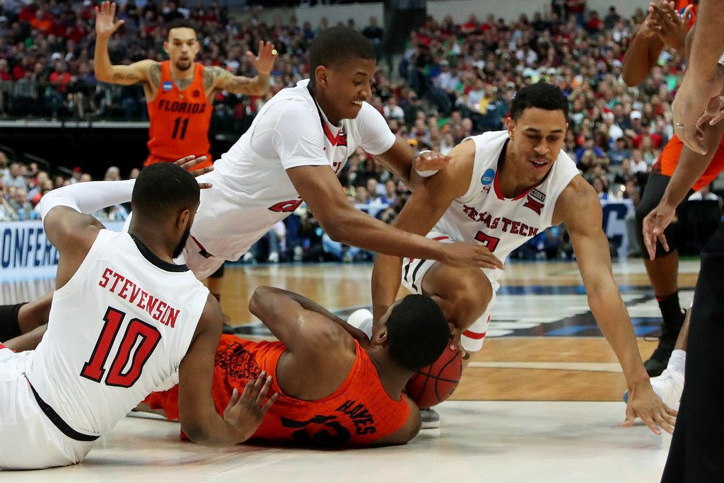 DALLAS, TX - MARCH 17:  Niem Stevenson #10, Jarrett Culver #23, and Zhaire Smith #2 of the Texas Tech Red Raiders battle for a loose ball against Kevarrius Hayes #13 of the Florida Gators in the first half during the second round of the 2018 NCAA Tournament at the American Airlines Center on March 17, 2018 in Dallas, Texas. (Photo by Tom Pennington/Getty Images)