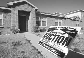 A home in Lancaster was up for auction this year. More than 61,000 homes in Dallas-Fort Worth were threatened with foreclosure this year, up a record 23 percent from 2008.